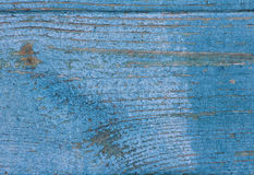 Fragment of the old blue wooden plank with peeling paint, textur Stock Photos