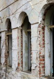 Fragment of old brick building destroyed with arcaded windows Stock Photo