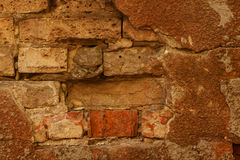 Fragment of Old Brick wall background. Old Brick dilapidated wall background with fragment of plaster Stock Photos