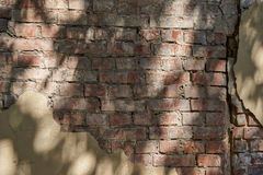 A fragment of an old brick wall with remnants of plaster Royalty Free Stock Photo