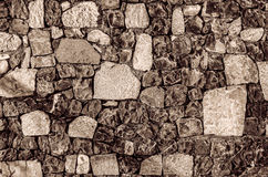 Fragment of old brick wall with river stones texture white grey brown black green blue lime yellow orange maroon violet pink turqu Royalty Free Stock Photo