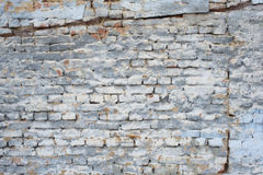 Fragment of old brick wall with white gray and blue colors Royalty Free Stock Image