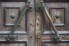 Fragment of old brown door with handle and lock Royalty Free Stock Photography