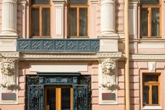 Fragment of an old building facade with ornate decoration. RUSSIA, SAINT PETERSBURG - AUGUST 18, 2017: Fragment of an old building facade with ornate decoration Royalty Free Stock Image