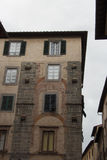 Fragment of old building in Lucca. Italy. stock photography