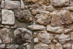 Fragment of the old city wall. The photo shows a fragment of the old city wall Royalty Free Stock Photo