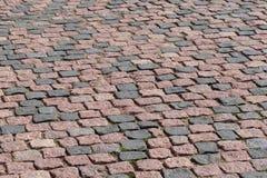 Fragment of old cobblestone road , the cobblestones stock image