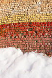 Old colorful mosaic outdoors in winter. Fragment of an old colortul mosaics partially covered with snow in fine winter day Stock Photos