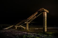 Fragment of the old conrete bridge near seaside of Nabran. North of Azerbaijan. Caspian Sea at night time with freezelight on it w. Ith different colors. View royalty free stock photography