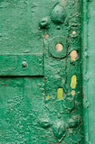 Fragment of the old crackled gates Royalty Free Stock Photo
