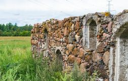 Fragment of the old destroyed wall from the stone house royalty free stock photos