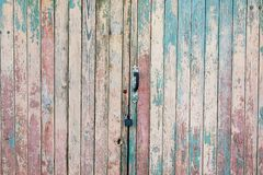 Fragment of the old and dilapidated doors stock photo