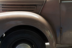 Fragment of old and dusty car close up Royalty Free Stock Image
