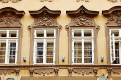 Fragment of old facade at a historic building with windows Stock Images