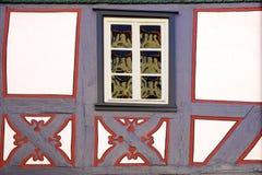 Fragment of old fachwerk house. Background. Fragment of old fachwerk houses with window Stock Photography