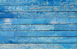 Fragment of an old fence. Cracked azure paint texture. Light blue wooden planks background. Stock Image