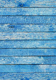 Fragment of an old fence. Cracked azure paint texture. Light blue wooden planks background. Royalty Free Stock Photography