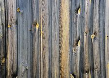Fragment of an old fence. Raw wooden planks background or texture. Fragment of an old fence. Raw wooden planks background, texture stock photography