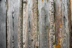 Fragment of an old grey rough-hewn fence. Wooden texture. Texture, background.Old unpainted wood surface. Wooden plank stock image