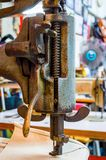 Fragment of the old heavy sewing machine. Clothing industry. Sewing workshop Stock Photo