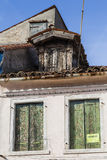 Fragment of old house. With closed shutters offered for sale Stock Images