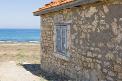 A fragment of an old house. Fragment of a wall of an old house by the sea Stock Image