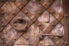 Fragment of the old iron door. Metal doors. Fragment of the old iron door. Forged handle on the background of metal doors Stock Photography