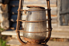 Fragment of an old lamp. Antique oil lamp against the wall village house Stock Images
