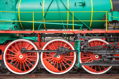 Fragment of old locomotive on rails Stock Photography