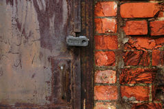 Fragment of an old metal door closed with a lock Royalty Free Stock Images