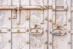 Fragment of old metal door. Horizontal Stock Images