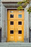 Fragment of an old Moscow building. Wooden door close up. royalty free stock photos