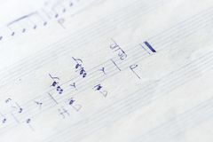 Fragment of an old musical notebook with hand written notes