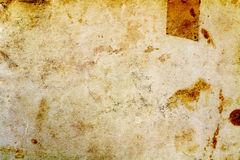 Fragment of old paper texture with dark spots. Abstract background Stock Photos