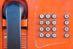 Fragment old payphone with push button closeup. Fragment or part of the old payphone of red color and with a push button set of number closeup royalty free stock images