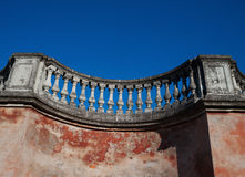 Fragment of old pink wall with balustrade Stock Images