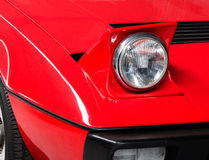 Fragment of an old red sports car close up Royalty Free Stock Photo