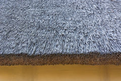 Fragment of the old reed roof. Stock Image