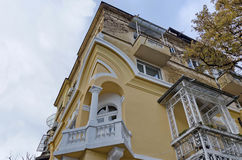 Fragment of old renovated building with balcony and ornaments Stock Images