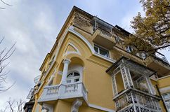 Fragment of old renovation house with corner balcony Royalty Free Stock Images