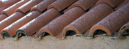 Fragment of old roof tile Stock Image