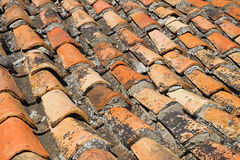 A fragment of the old roof tiles. Detail of old a tiled roof. Architecture, exterior Royalty Free Stock Photography