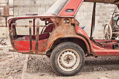 Fragment of old rusty car without doors Royalty Free Stock Images