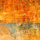 Fragment of old scratched colorful surface as background Stock Photos