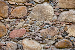 A fragment of an old stone wall Royalty Free Stock Images