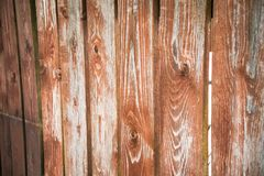 Fragment of an old textured brown fence.Wooden texture. Texture, background.Old wood painted surface. The structure of the wall stock photos