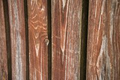 Fragment of an old textured brown fence.Wooden texture. Texture, background.Old wood painted surface. The structure of the wall stock images