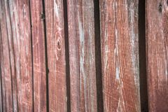 Fragment of an old textured brown fence.Wooden texture. Texture, background.Old wood painted surface. The structure of the wall royalty free stock photo