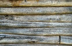 Fragment of an old timbered wall. Wood is corroded wreckers Royalty Free Stock Image