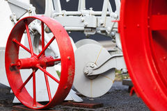 Fragment of old tractor with red wheels Royalty Free Stock Images